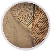 Footprints On The Beach Along A Fence Round Beach Towel