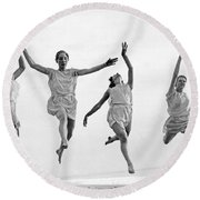 Four Dancers Leaping Round Beach Towel