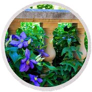 Garden Wall With Periwinkle Flowers Round Beach Towel