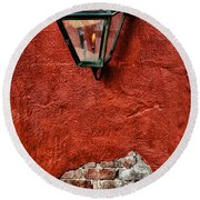 Gaslight On A Red Wall Round Beach Towel