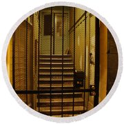 Gated Stairwell At Night Round Beach Towel