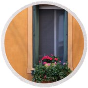 Geraniums In A Yellow Window In Treviso Italy Round Beach Towel
