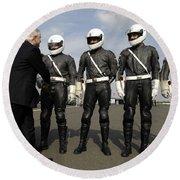 German Motorcycle Police Shake Hands Round Beach Towel by Stocktrek Images