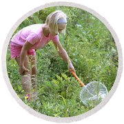 Girl Collects Insects In A Meadow Round Beach Towel by Ted Kinsman