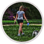 Girl Walking Dog Round Beach Towel by Paul Ward
