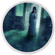 Girl With Candle In Doorway Round Beach Towel