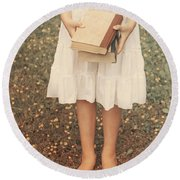 Girl With Old Books Round Beach Towel