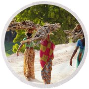 Group Of Women Carrying Firewood Near Round Beach Towel