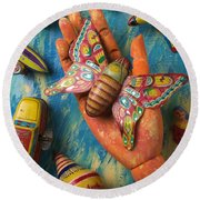 Hand Holding Butterfly Toy Round Beach Towel