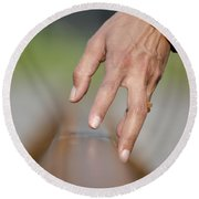Hand Touching A Railroad Track Round Beach Towel