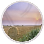 Hay Bales And Sunrise In Fog Round Beach Towel