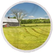 Hay Being Harvested Near Barn In Maine Round Beach Towel