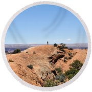 Hiker At Edge Of Upheaval Dome - Canyonlands Round Beach Towel