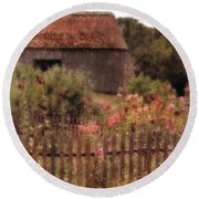 Hollyhocks And Thatched Roof Barn Round Beach Towel