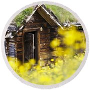 House Behind Yellow Flowers Round Beach Towel