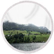 Houses On The Greenery Of The Slope Of A Mountain Next To Lake Lucerne Round Beach Towel