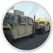Humvees Sit On The Pier At Morehead Round Beach Towel
