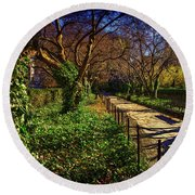 In The Conservatory Garden Round Beach Towel