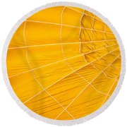 Inflating Folds Of Yellow Round Beach Towel