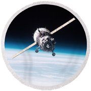 Iss Crew Arriving By Soyuz Spacecraft Round Beach Towel by NASA / Science Source