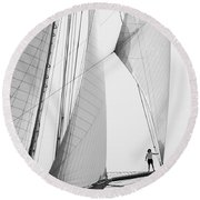 king of the world - a classic sailboat with all sails plying the sea on the island of Menorca Round Beach Towel