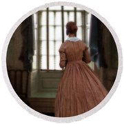 Lady In 19th Century Clothing Looking Out Window Round Beach Towel