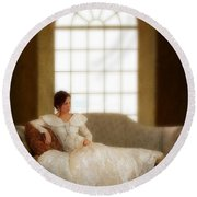 Lady Sitting On Sofa By Window Round Beach Towel