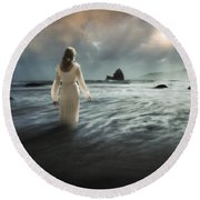 Lady Wading Into The Sea In The Early Morning Round Beach Towel