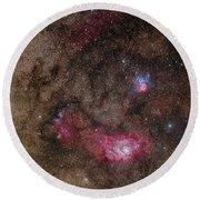 Lagoon Nebula And Trifid Nebula Round Beach Towel