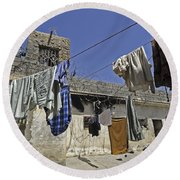 Laundry Hangs In The Courtyard Round Beach Towel