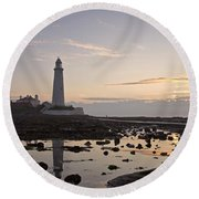 Lighthouse At Low Tide Round Beach Towel