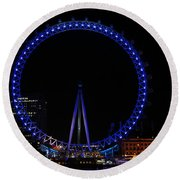 London Eye All Done Up In Blue Light In The Night With A Small Reflection In The Thames Round Beach Towel