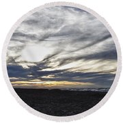 Low Hanging Clouds At Sunset Round Beach Towel