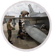 Maintenance Crew Works On Replacing Round Beach Towel by HIGH-G Productions