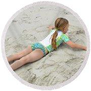 Making A Sand Angel Round Beach Towel