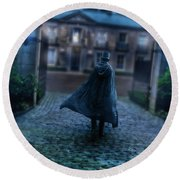 Man In Top Hat And Cape On Cobblestone Street Round Beach Towel