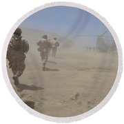 Marines Move Through A Dust Cloud Round Beach Towel