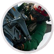 Mechanic Inspects An Mh-60r Sea Hawk Round Beach Towel