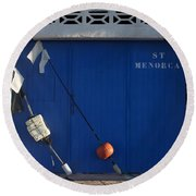 menorca st - A warehouse door in Es Castell Menorca ready to keep local tradicional boats llauts Round Beach Towel