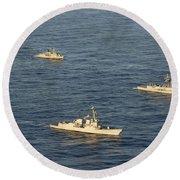 Multinational Navy Ships Move Round Beach Towel
