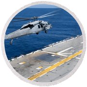 N Mh-60s Sea Hawk Helicopter Lifts Round Beach Towel