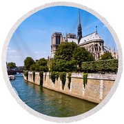 Notre Dame Cathedral Along The Seine River Round Beach Towel