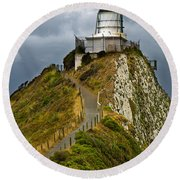 Nugget Point Light House And Dark Clouds In The Sky Round Beach Towel