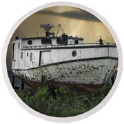 Old Fishing Boat On Shore With Storm Moving In Round Beach Towel