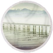 Old Wooden Bridge Into A Mountain Lake On A Foggy Morning Round Beach Towel