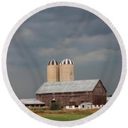 Ominous Clouds Over The Barn Round Beach Towel