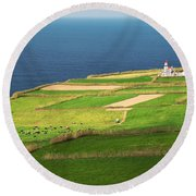 Pastures And Lighthouse Round Beach Towel