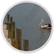 Pelican In The Water Next To A Timber Landing Pier Round Beach Towel
