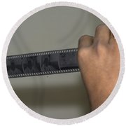 Person Holding A Strip Of Photo Negatives Round Beach Towel