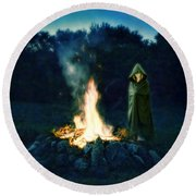 Person Standing By A Bonfire In The Moonlight Round Beach Towel